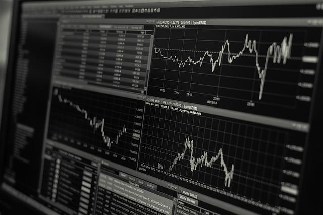 経済の動向を表したモノクロのグラフ