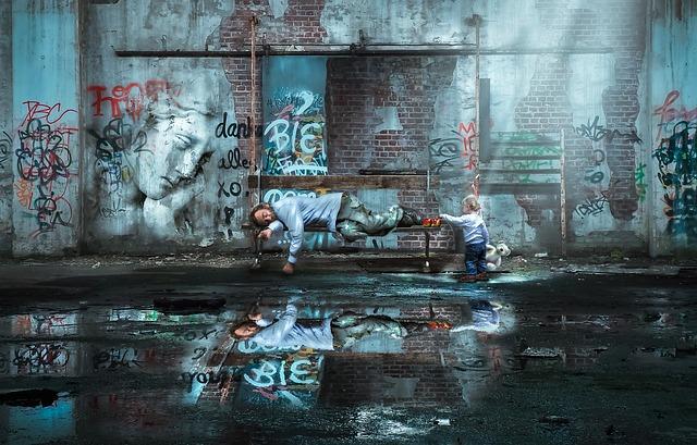 落書きだらけの街のベンチで寝ている男性を起こそうとする幼子