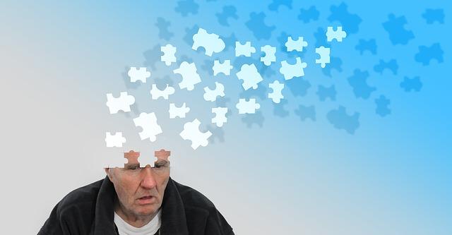 ジグソーパズルの様に頭部が消えていく無気力な男性