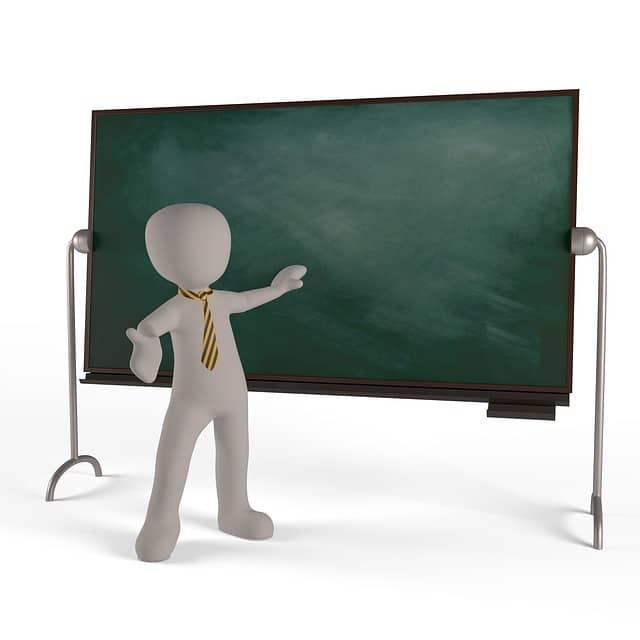 黒板の前で何かを教えるネクタイをしたピクトグラム