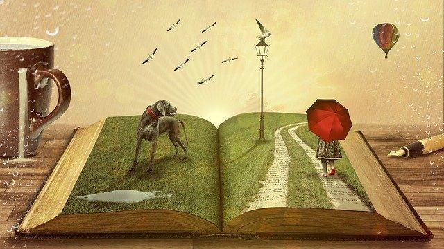開いた本に描かれている実際の世界の様なイラスト
